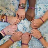 photo of developing doulas trainees holding hands