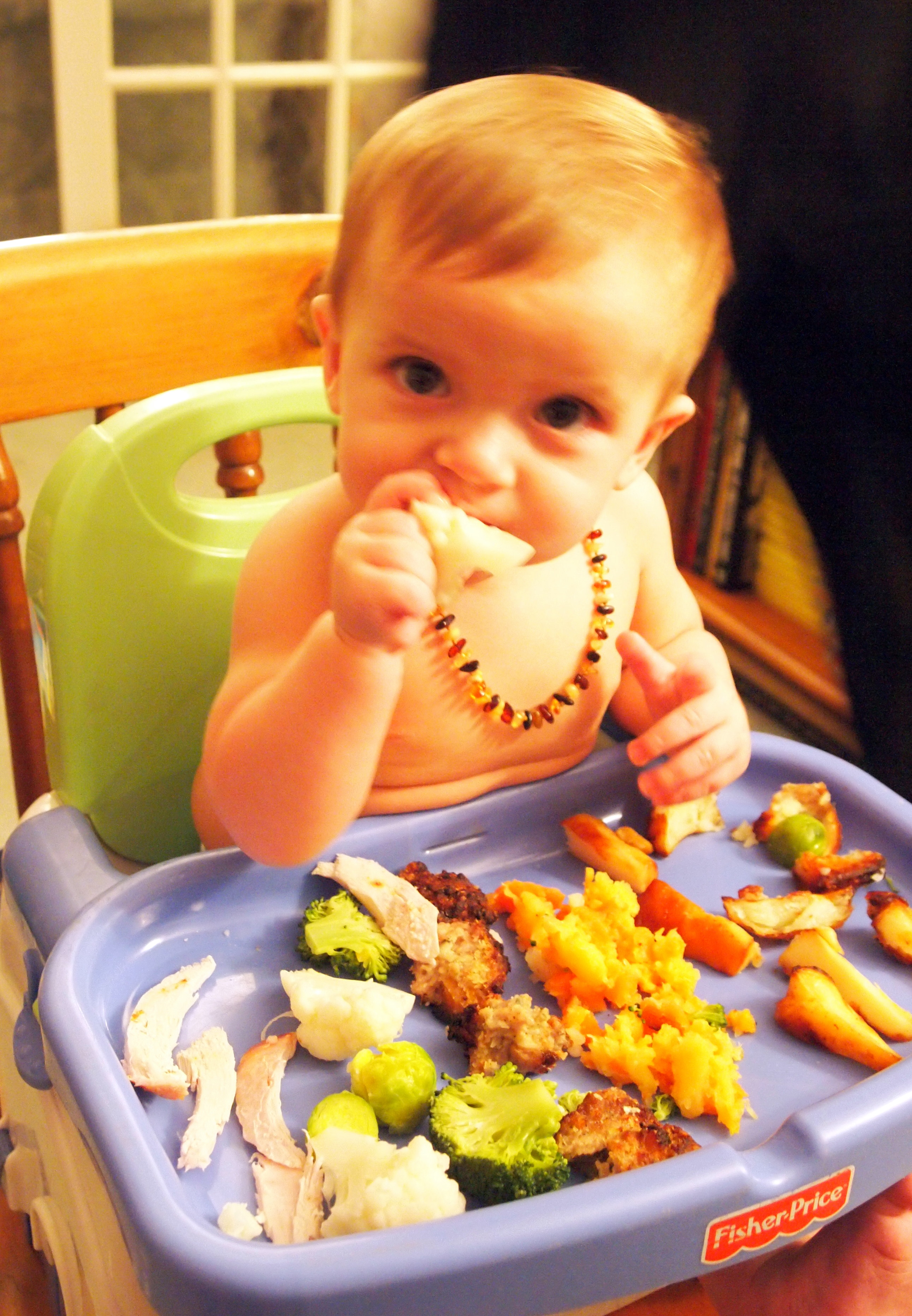 baby eating sunday lunch